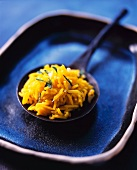 Saffron rice on a metal spoon