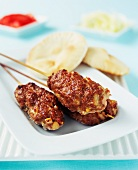 Lamb skewers and pitta bread