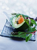 Avocado with smoked salmon, capers and lettuce leaves