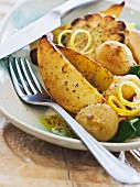 Potatoes, garlic and onions cooked in the oven with lemon and herb vinaigrette
