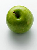A Granny Smith Apple on a white background
