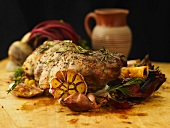 Sliced leg of stuffed lamb with garlic, rosemary and roast onion