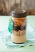 Couscous, chickpeas, raisins, almonds and dried apricots layered in a screw-top jar