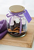 A jar containing dry ingredients for making Rocky Road (chocolate and marshmallow cake, USA)