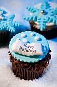 Chocolate Winter Cupcakes with Happy Holidays Decoration and Blue Snowflakes