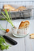 Pastry whirls in a bowl with garlic dip