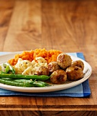 Meatballs with mashed sweet potato and vegetables