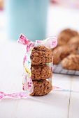 A stack of oat biscuits with a gift ribbon
