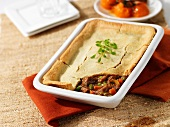 Beef ragout with a pastry lid