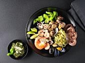 Frutti di mare salad on a black plate