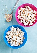 Popcorn in bowls with colourful sugar sprinkles