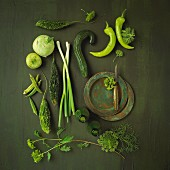 An arrangement of green vegetables and herbs