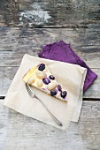 A slice of grape and sour cream tart