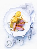 Duck breast with braised chicory and duchess potatoes