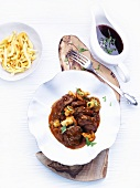 Pot-roasted calf's cheeks with chanterelles and tarragon