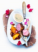 Rack of lamb with aromatic cardamom & espresso caramel sauce and peaches