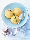 Three potato dumplings with chives