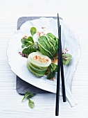 Stuffed rolled lettuce leaves with lamb's lettuce and a peanut sauce (China)