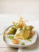 Ravioli with herb sauce and fried onions