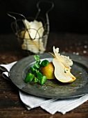 Pears with cress and parmesan chips and olive oil