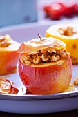 Baked apples stuffed with nuts and honey