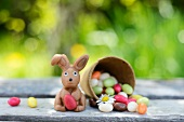 Chocolate bunny and jelly beans on a garden table