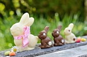 Chocolate bunnies and jelly beans on a garden table