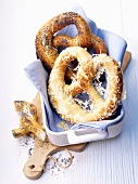 Yeast pretzels with cheese and poppy seeds