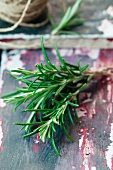 Fresh rosemary on a colorful, wooden surface