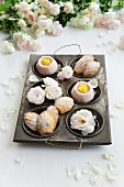 Madeleines and wagashi with roses in an antique baking tray with roses