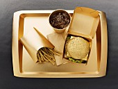 Fast food with a gold-coloured disposable food set