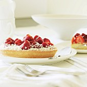 Strawberry cake with grated coconut