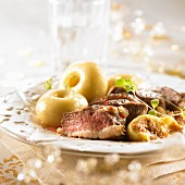 Duck breast with figs and dumplings