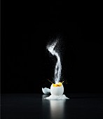 A soft egg with a splash of salt