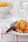 Tagliatelle with tomato sauce, black olives, fennel and saffron threads