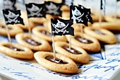 Biscuits with chocolate ganache as pirate ships