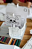 A pirate boat crafted out of paper