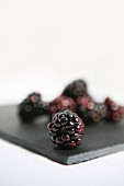 Blackberries on a black board