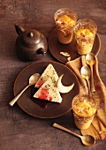 Turkish desserts: pistachio parfait with pomegranate syrup and almond pudding with saffron