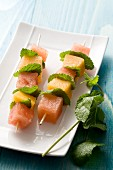 Melon skewers with mint leaves