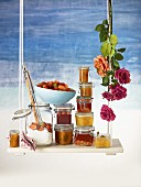 Assorted jams, fresh fruit and preserving sugar