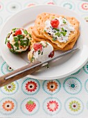 Goat's cream cheese balls with redcurrants and chives