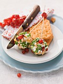 Cream cheese balls on skewers with redcurrants