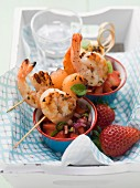 Melon and scampi skewers with strawberry salsa