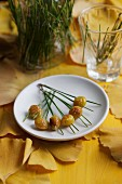 Gingko nuts on pine needles with autumnal leaf decoration