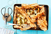Potatoes with camembert baked in parchment