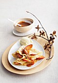 Gingerbread crepes with baked apple wedges and caramel sauce