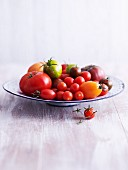 A variety of tomatoes on a plate