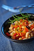 Bean salad with white beans, tomatoes and duck