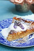 Juicy apple cake with cream and lavender flowers
